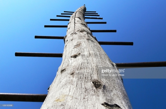 ladder-pole-reaching-up-into-deep-blue-sky-picture-id129150556